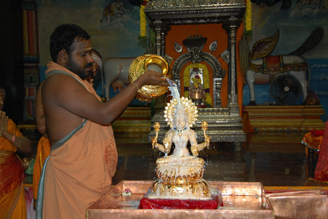Beloved Amma performs the abhishekam on Swarna Lakshmi