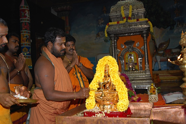 Beloved Amma performs the aarathi