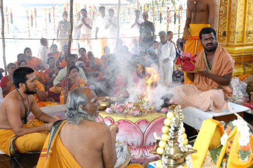 Amma recites mantras before making the offering