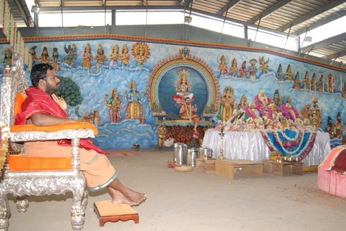 Beloved Amma looks on at the Yagam