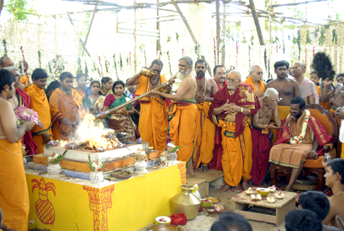 Priests offering ghee to fire