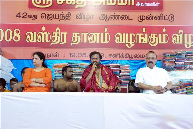 Guests on stage with Beloved Amma