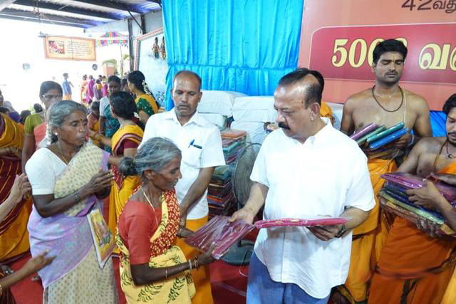 Beloved Amma distributes the sarees