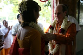 The couple garland each other
