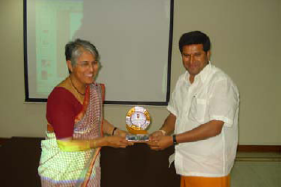 Director presents Dr. Alka with a memento