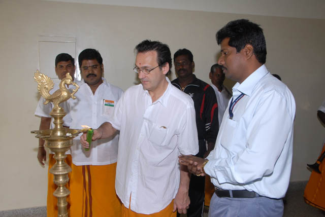 Mr. Dino from New York USA lights the Kuthuvillaku lamp