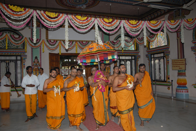Priests in procession with the Kalasams after the Homam