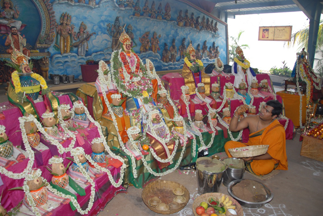 Priest chants the mantras and offers the flowers