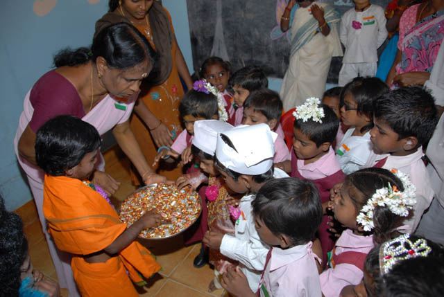 Sweets are distributed to everyone
