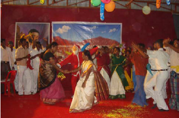 Members of staff perform a dance