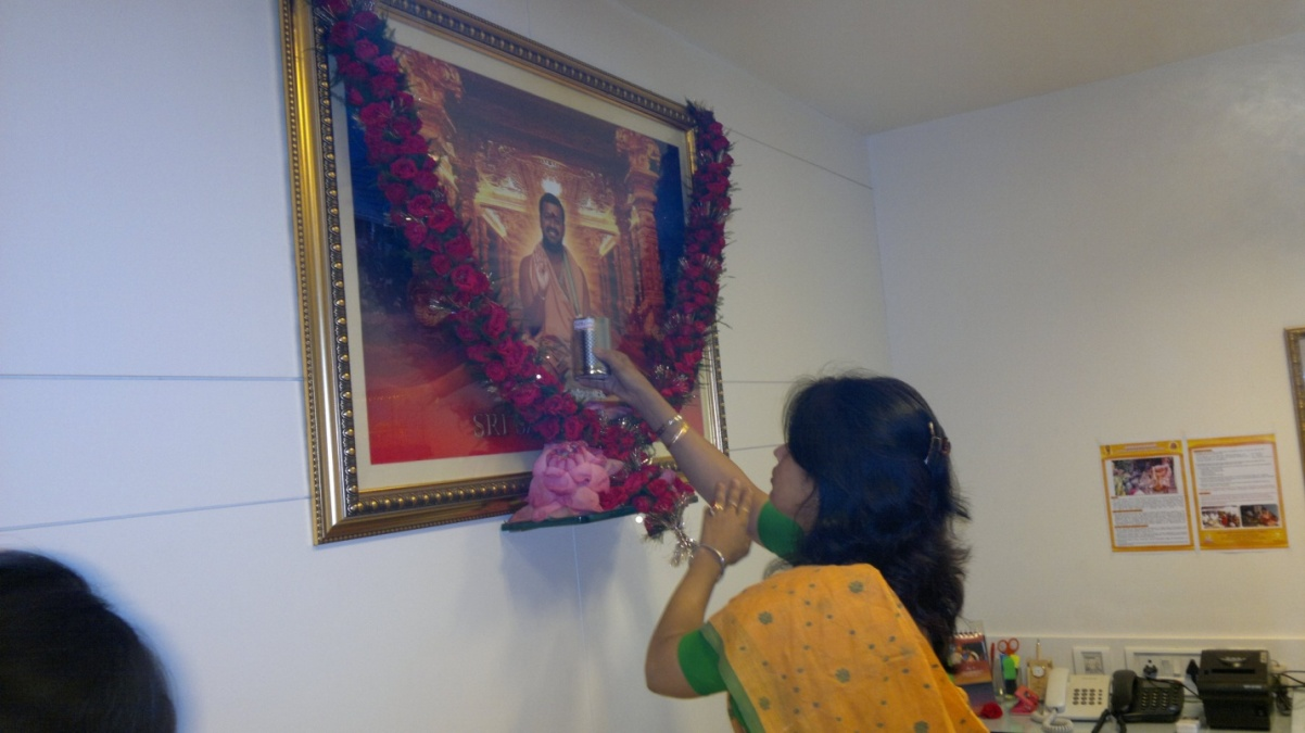 Devotee perform the puja