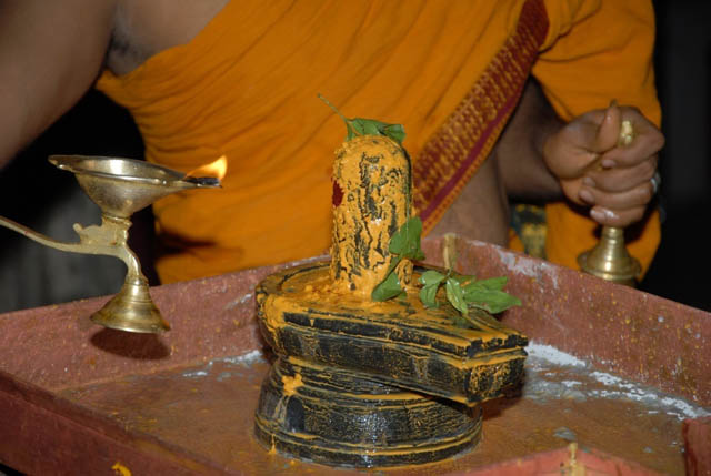 Priest does the arathi to Lord Shiva