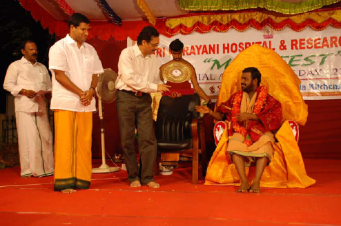 Beloved Amma presents a memento to the chief guest