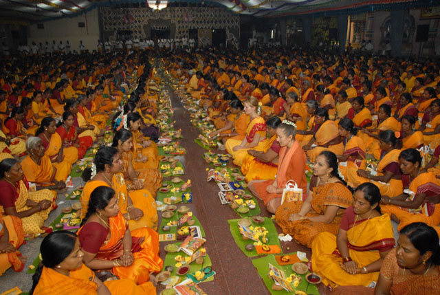 Devotees perform the puja