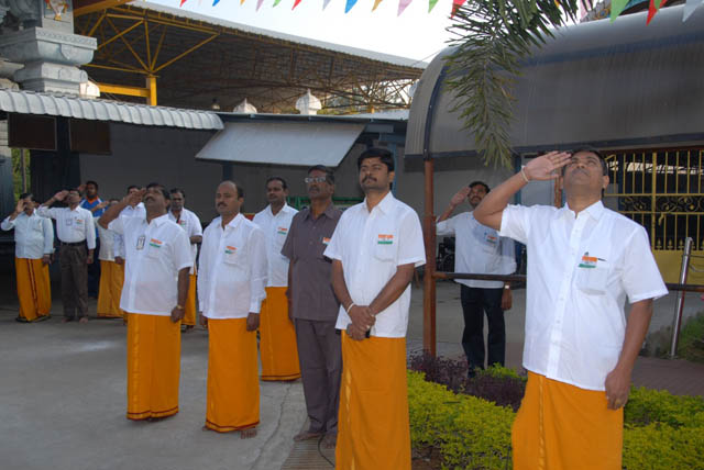 Employees honour the National Flag
