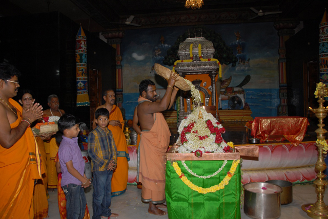 Beloved Amma performs the flower abhishekam on Swarna Lakshmi