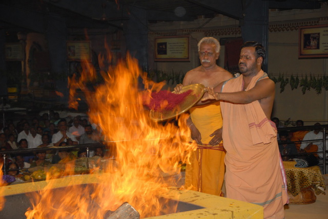 Beloved Amma adds kum kum into the fire