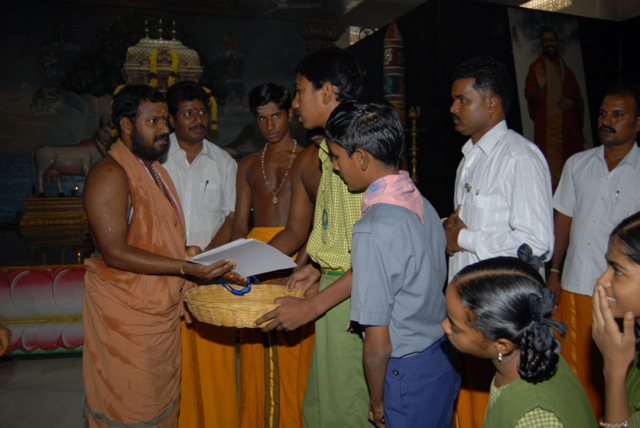 Beloved Amma gives out the prizes and medals
