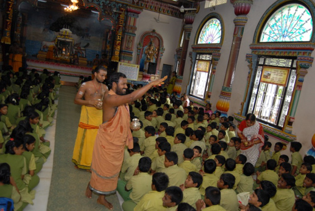 Sri Sakthi Amma blesses the students with holy water after the Yagam.