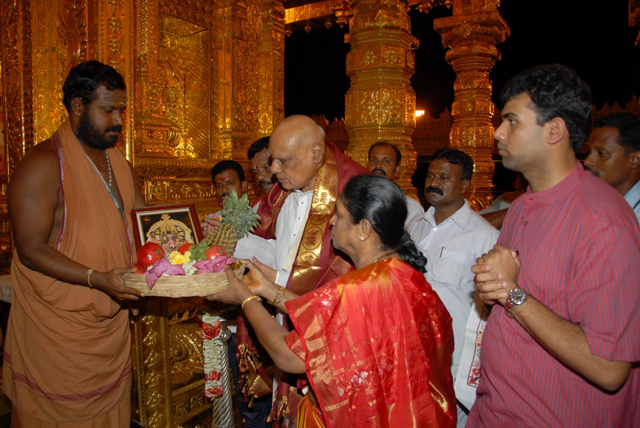 His Excellency and family receive prasadam from Sri Sakthi Amma
