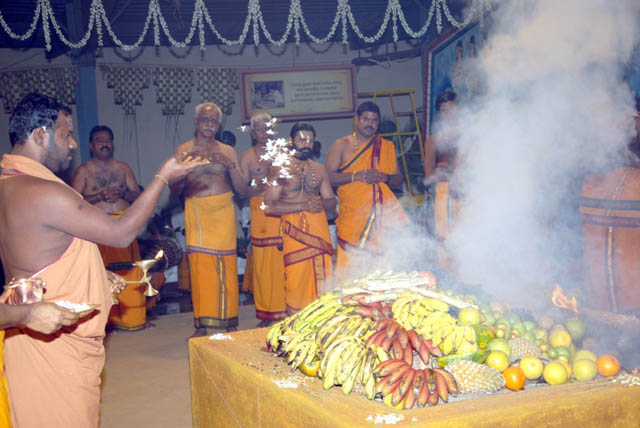 Sri Sakthi Amma offers flowers