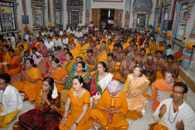 Devotees attend the Sri Sakthi Geetham