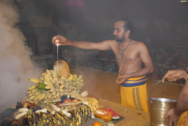 Priest does the abhishekam