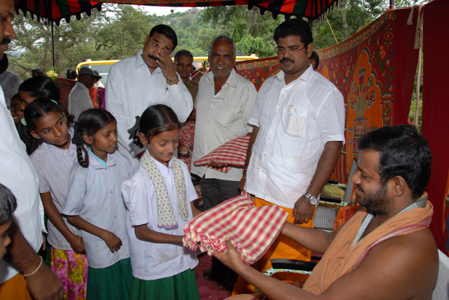 Beloved Sri Sakthi Amma gives clothing to the young girls