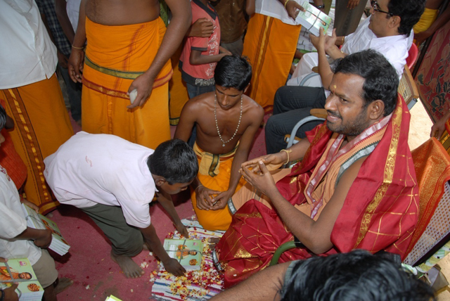 Student receives the blessings of Sri Sakthi Amma