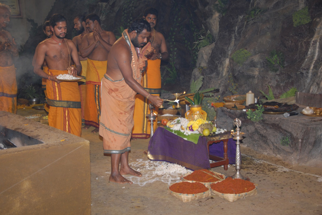 Beloved Amma performs the puja to start the Yagam