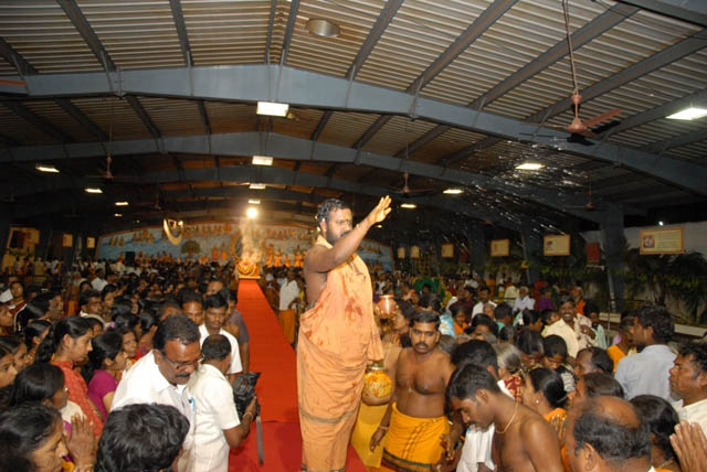 Sri Sakthi Amma blesses the gathering with holy water