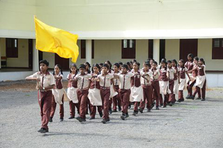 Student perform the march past