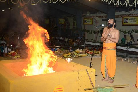 Priest chant the mantras while conducting the Yagam
