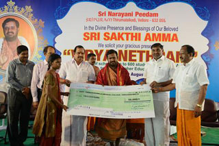 Beloved Amma presents the cheque